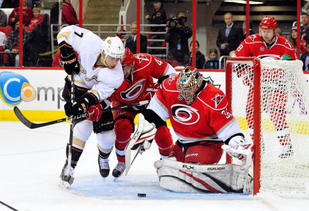 Andrew Cogliano tries to get his stick on a rebound in front of Justin Peters (Grant Halverson/Getty Images)