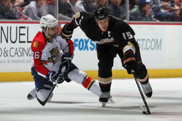 Ryan Getzlaf battles for a loose puck against the Panthers in the '10-'11 season. (Jeff Gross/Getty Images)