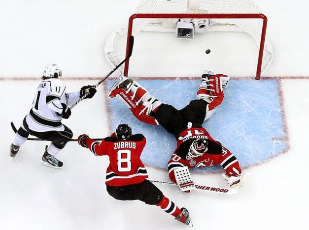 Anze Kopitar scores against Marty Broduer in Game 1 of the 2012 Stanley Cup Final. (Bruce Bennett/Getty Images)