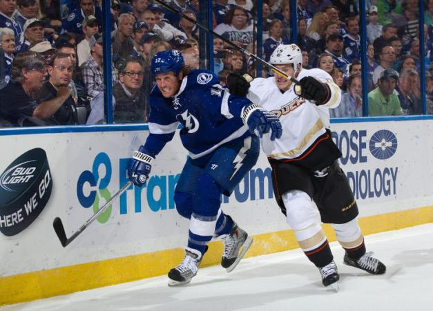 Ryan Malone and Ryan Getzlaf battle for board position during the '11-'12 season (Scott Audette/Getty Images)